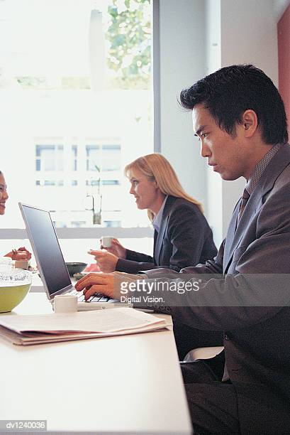 Businessman Working on a Laptop in a Restaurant