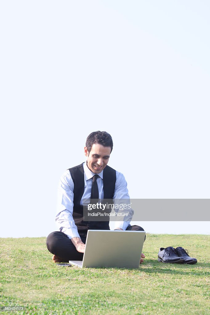 Businessman working on a laptop , INDIA , DELHI : Stock Photo