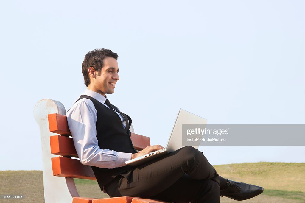Businessman working on a laptop , INDIA , DELHI : Stock Photo