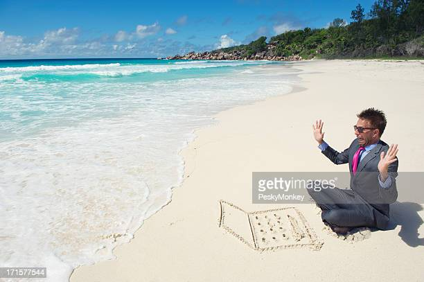 Businessman Working on Beach Gets Interrupted by Wave