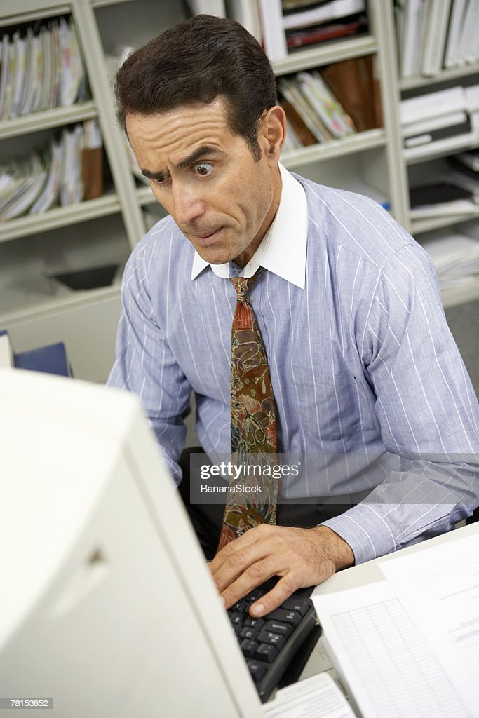 Businessman working on computer : Stock-Foto