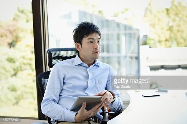Businessman working on digital tablet in office