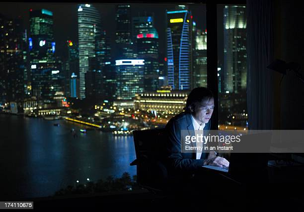 Businessman working on laptop computer at night