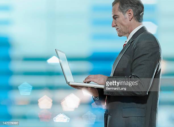 businessman working on laptop computer - newtechnology stock pictures, royalty-free photos & images
