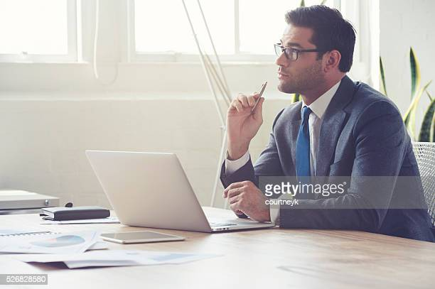 Businessman working on laptop computer.