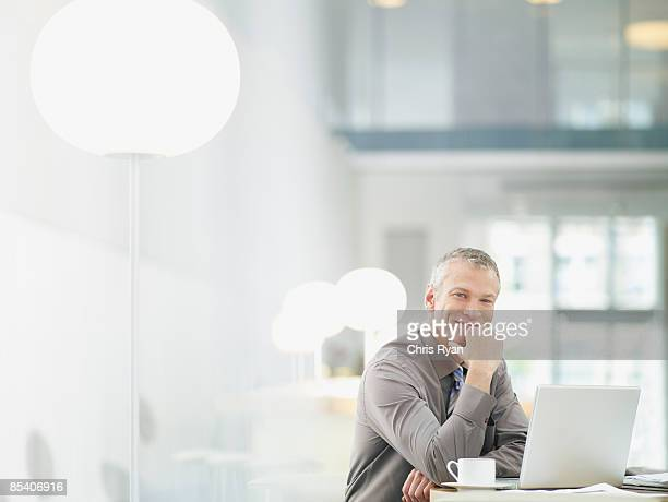 businessman working on laptop in cafe - man in office stock photos and pictures