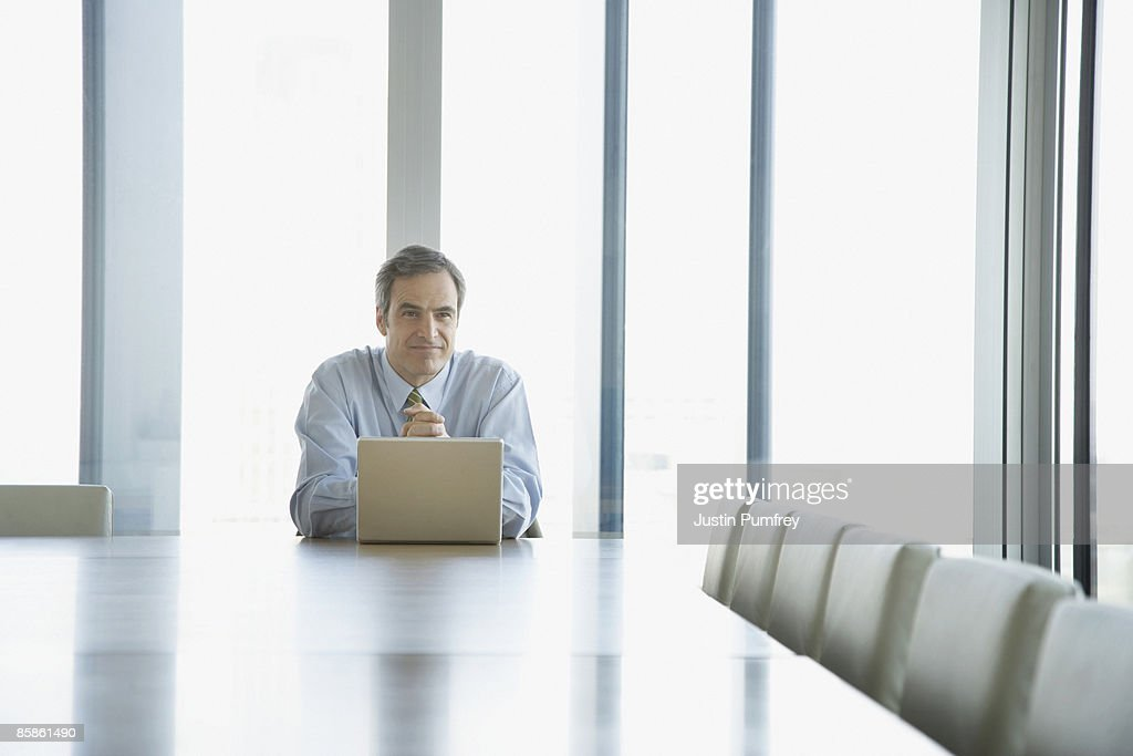 Businessman working on laptop in conference room : Stock-Foto