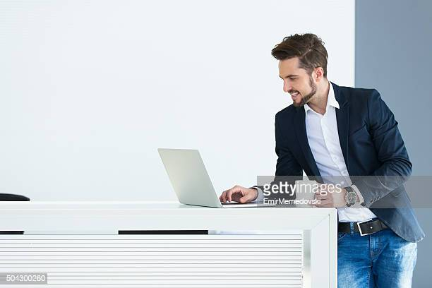businessman working on laptop - emir memedovski stock pictures, royalty-free photos & images