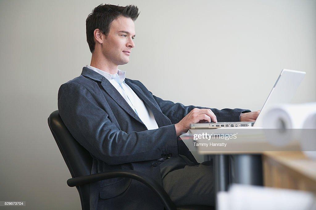 Businessman working on laptop : Photo