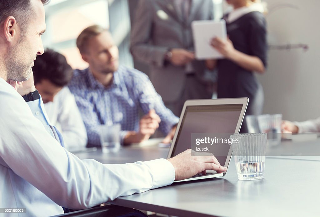 businessman working on latop in an office stock photo getty images