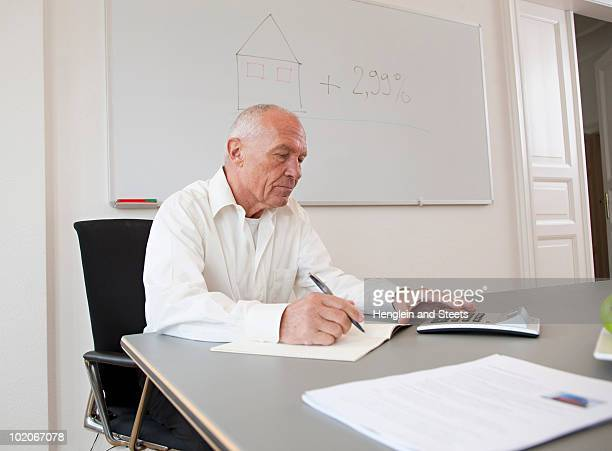 Businessman working on papers