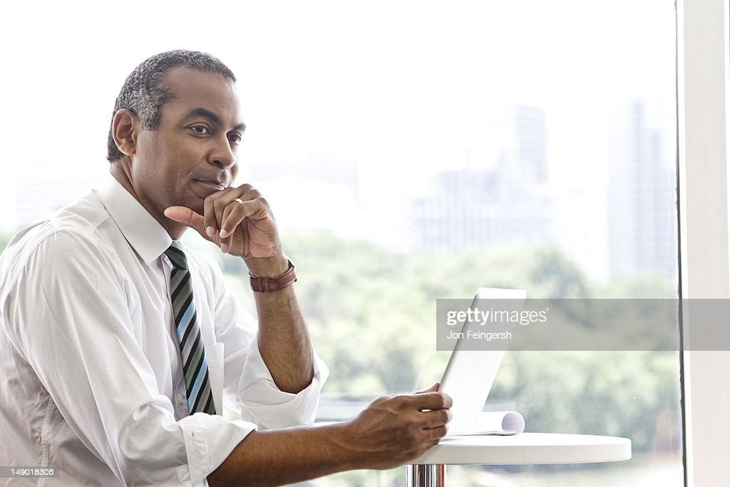 Businessman working on tablet device : Stock Photo
