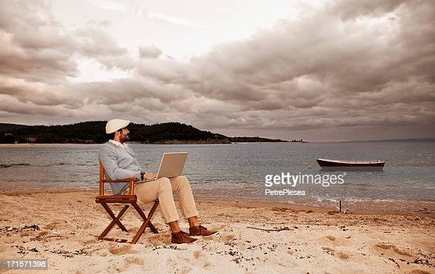 Businessman working on the Beach. Sunset. Concept. Toned image.