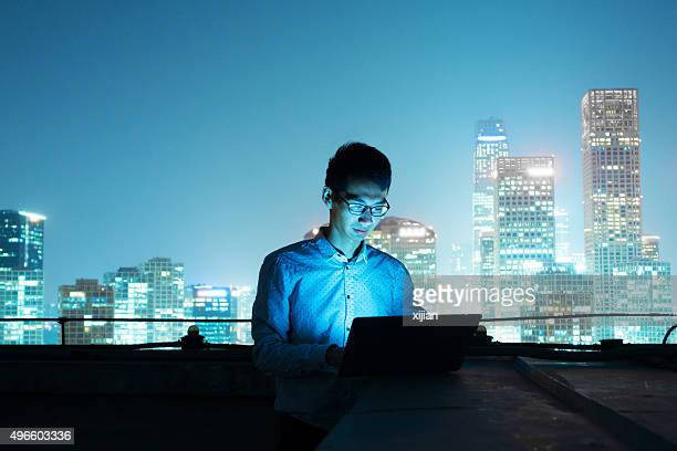 Businessman working on top of city skyline