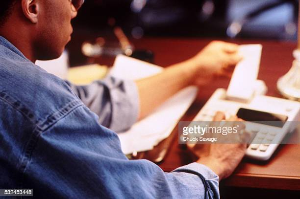 businessman working with adding machine - addierrolle stock-fotos und bilder