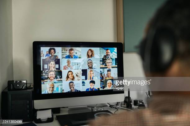 businessman working with colleague through video conferencing - live streaming stock pictures, royalty-free photos & images