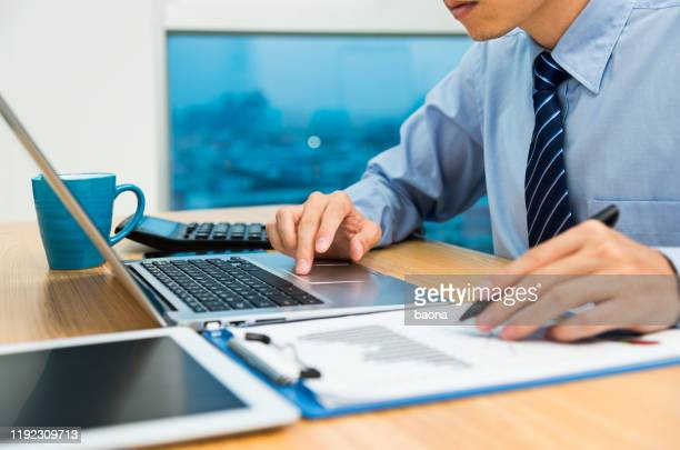 businessman working with digital tablet and laptop in office room - shirt and tie stock pictures, royalty-free photos & images