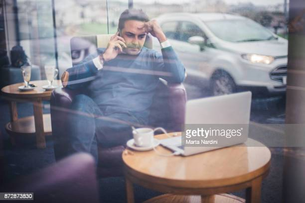 Businessman working with laptop and telephone