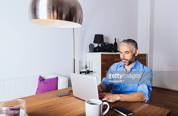 Businessman working with laptop at home office