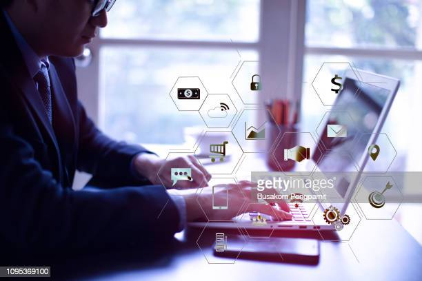businessman working with laptop computer and digital tablet and smart phone in modern office with virtual icons interface