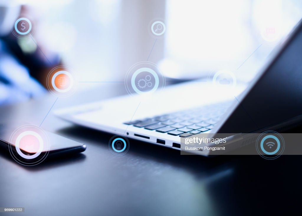 Businessman working with laptop computer and digital tablet on table. Business and technology icons concept. : Stock-Foto