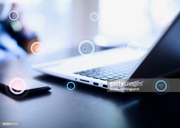 businessman working with laptop computer and digital tablet on table. business and technology icons concept. - marketing icons stock photos and pictures