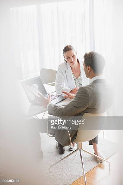 Businessman working with scientist in conference room