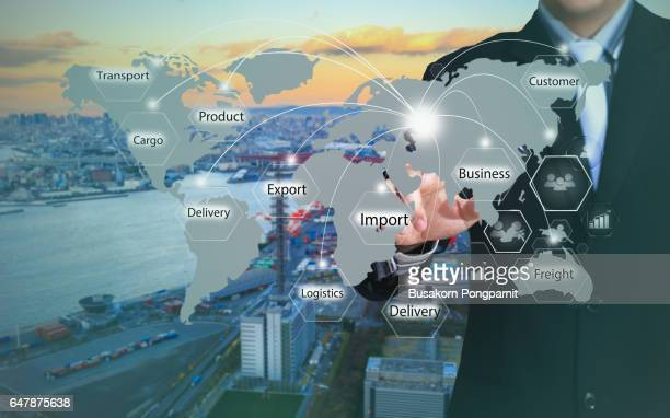 Businessman working with virtual interface connection map of global network for logistic,import,export background.
