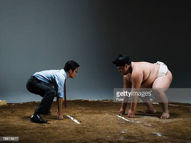 Businessman Wrestling Sumo Wrestler
