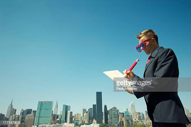 Businessman Writing Love Note Memo by Skyline