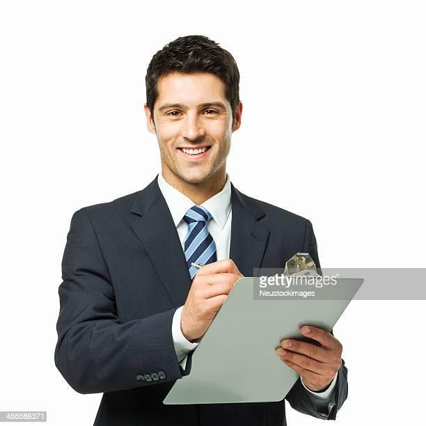 Homme d'affaires écrit sur un presse-papiers-isolé