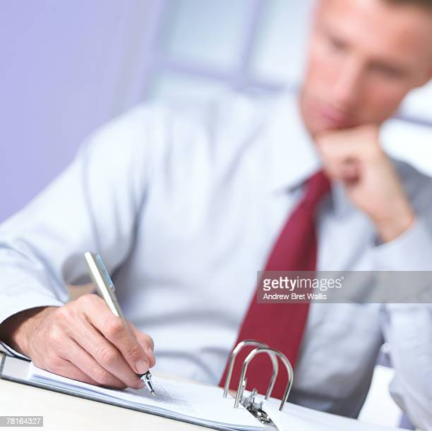 businessman writing - andrew chin stock pictures, royalty-free photos & images