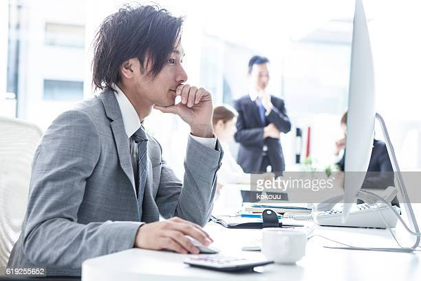 Businessman you are using a computer in the office