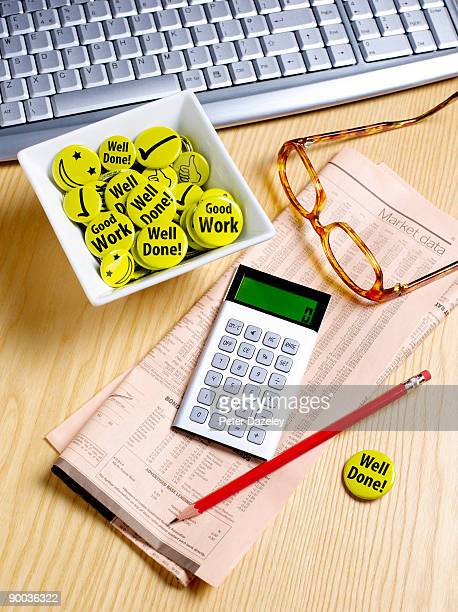 Businessman's desk with motivation badges.
