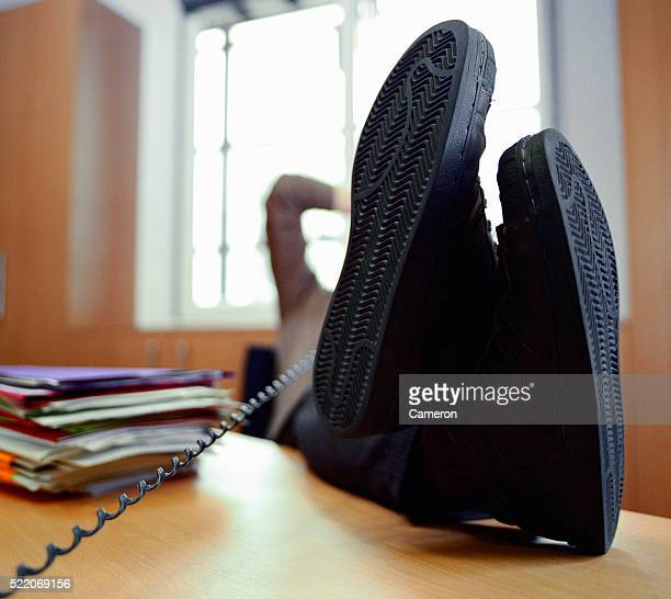 Businessman's Feet on Desk While Telephoning