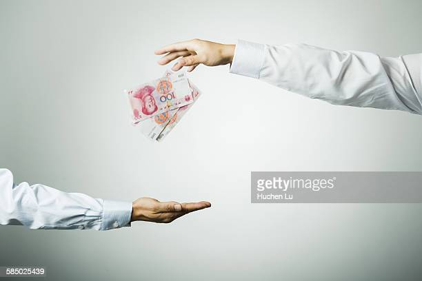 businessman's hand holding money - long sleeved stock pictures, royalty-free photos & images