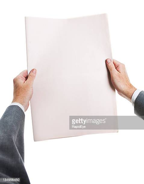 Businessman's hands hold blank newspaper ready for your headlines