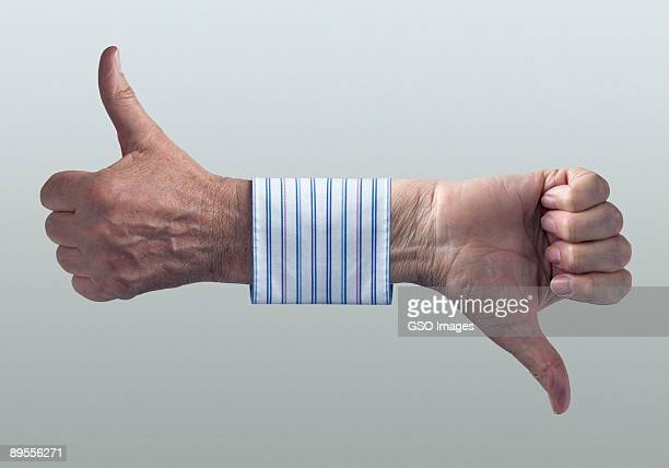 businessmans hands showing thumbs up and down. - failure stock pictures, royalty-free photos & images