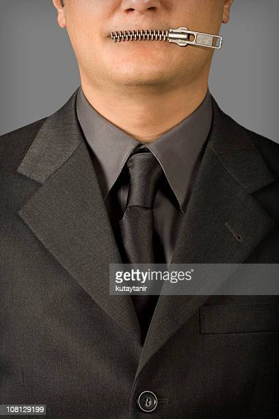 Businessman's Mouth with Zipper