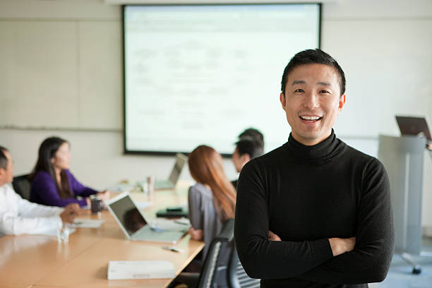 businessman's portrait under meeting - asian man in the office stock pictures, royalty-free photos & images