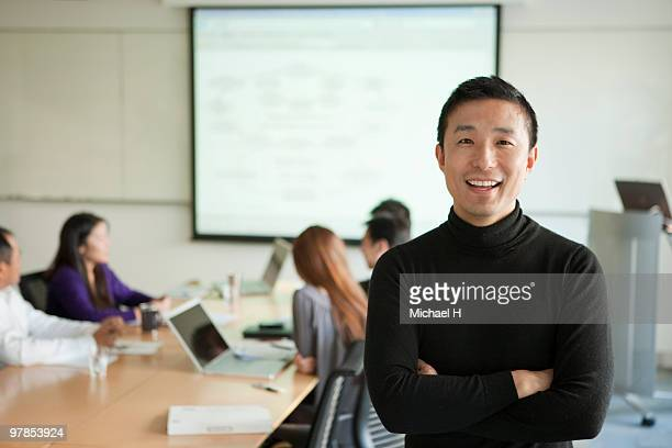 businessman's portrait under meeting - 30 39 years stock pictures, royalty-free photos & images