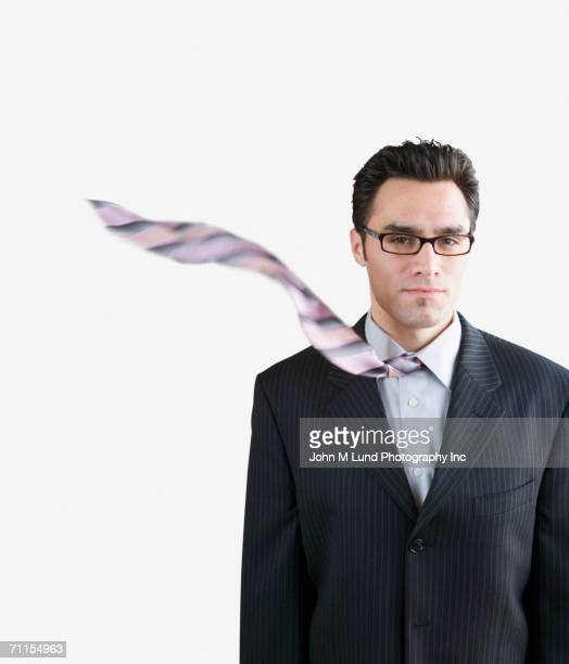 Businessman's tie blowing in the wind