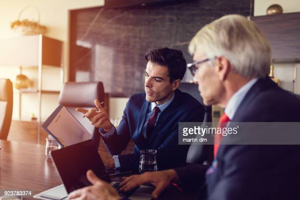 businessmen analyzing marketing graphics - business plan stock pictures, royalty-free photos & images