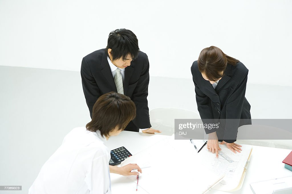 Businessmen and Businesswoman In Meeting, High Angle View : Photo