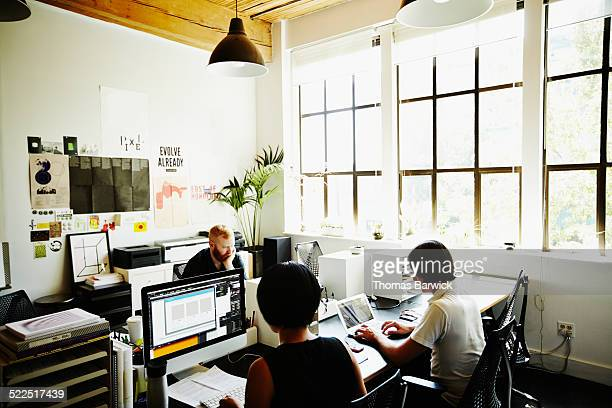 Businessmen and businesswoman in startup office