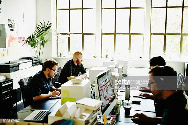 Businessmen and businesswoman working in office