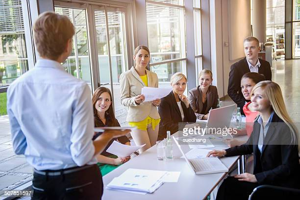 Businessmen and businesswomen at brainstorming meeting