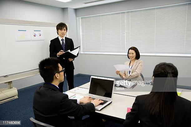 Businessmen and businesswomen having a meeting