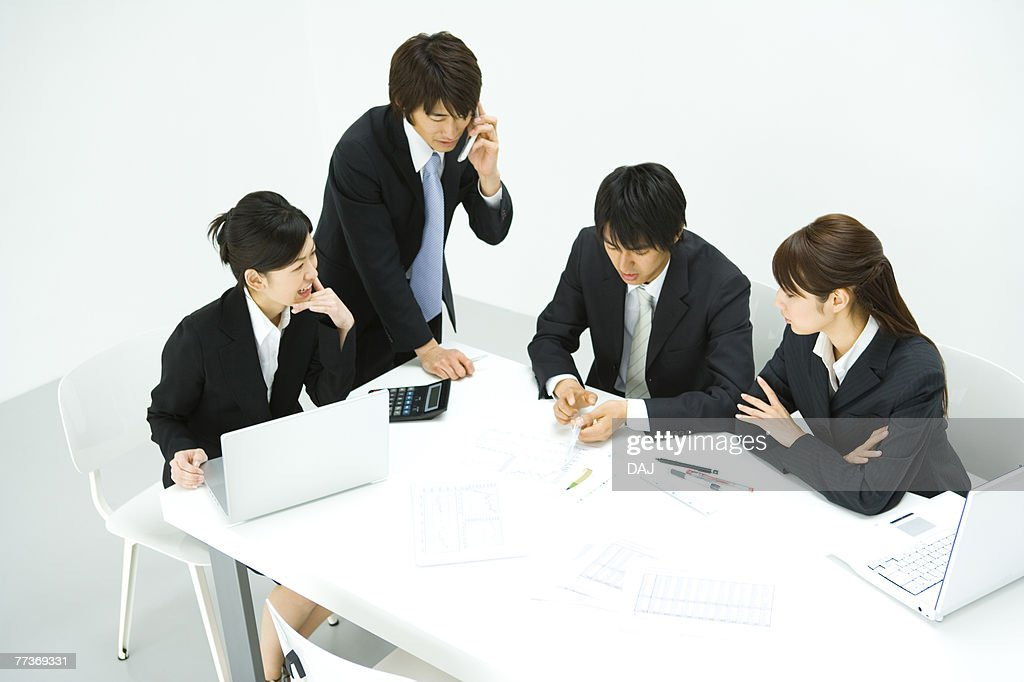 Businessmen and Businesswomen In Meeting, High Angle View : Photo