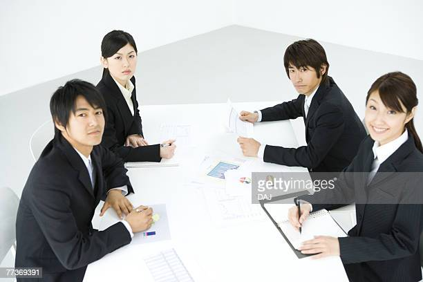Businessmen And Businesswomen In Meeting, Waist Up, Side View, High Angle View